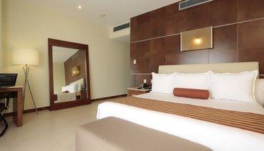 Quarto king standard Hotel Krystal Urban Cancún Cancún